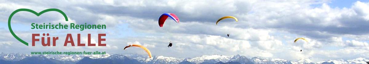 Paraglider fliegen vor einer beeindruckenden Kulisse aus Bergen und Wolken